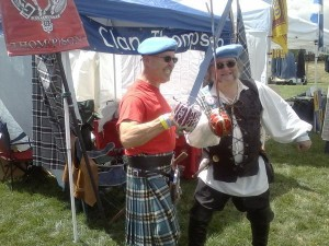 """Parker Thomson (left) and Michael Thompson """"discuss"""" the lowland origins of Clan Thompson using historically appropriate basket hilt claymore swords."""