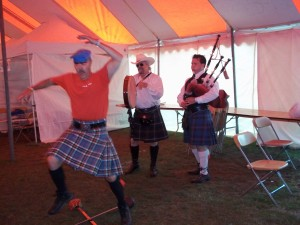 Parker Thomson does the sword dance, accompanied by Sean Thompson on the pipes and a member of a nearby clan on bodhrán.